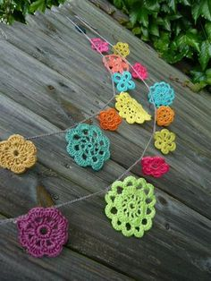 "Again, no instructions but very inspiring--a series of various round granny motifs in lots of colors, joined with a chain stitch ""rope""--great bunting for the screened porch I'm thinking."