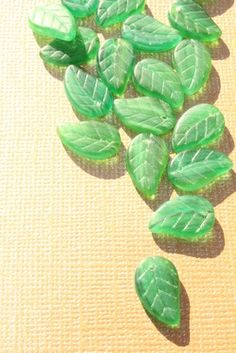 Gorgeous glass green autumn leaf beads, drilled with holes <3 These are coming up at 4pm in the #supplies #auction on #tophatter