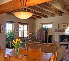 gorgeous beams, nice non-beehive fireplace better suited to high-efficiency insert