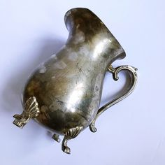 Excited to share this item from my #etsy shop: VINTAGE | 1950s silver plated ice guard paw footed pitcher #icelipguard #footedpitcher #antiquesilver #vintagesilver #silverpitcher #silverplated #demarsvintage