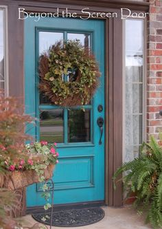 Turquoise Front Door...wondering if this will go with the shutters that are barn red, and the tan color of the house and the white trim.. too much ?? @Christina Childress & Feldman
