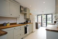 terraced small kitchen with french doors and table at end - Google Search
