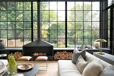 A wall of steel-paneled glass windows opens the common room to the outdoor space, creating an indoor-outdoor feel. Save for a finished basement and a few walls above ground, this Ontario, Canada residence, designed by Nicholas Ancerl of Ancerl Studio, was built completely anew to fulfill the homeowner's wishes of a country-chic home. #interiordesign #architecture #homedecor Ontario, Grand Entryway, Cabinet D Architecture, Interior Architecture, Style Loft, Industrial Windows, Appartement Design, Interiores Design, White Walls