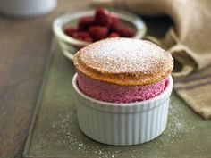 Perfectly pink, these raspberry and lemon soufflés will impress your guests, and are easier to make than you'd think! #souffle #raspberry #yum