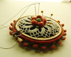 Jazzing up the doily pincushion by woolly  fabulous, via Flickr