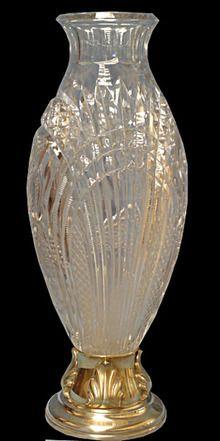 Maker: Bacarat/WMF Condition: Restored Year: C. Wonderful cut crystal Bacarat vase with WMF silver Base.