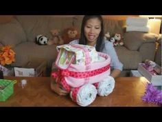 Baby Carriage Diaper Cake (How To Make) Its a REally cute one too!!!!! Made with baby wipes for the top/back part and just receiving blankets (no fleece blankie)... really easy to put together!