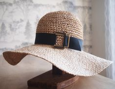 Straw floppy sun hat with black grosgrain ribbon by AmyLehfeldt, $150.00.    Hats similar to this are appearing all over beaches this summer.