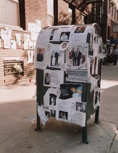 Notices & pictures of missing persons posted on a mailbox in New York City following the September 11, 2001, terrorist attacks.