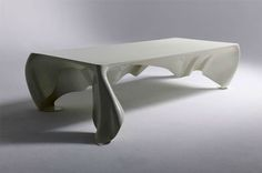 What a cool table! It's kind of ghost-y, but also kind of elegant. Designed by Graft Architects...