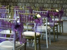 Wedding ceremony set up with purple organza sashes & white rose detail.  Want your own quote? Then email me with your ideas! hello@beckiemelvinevents.co.uk  More styles can be seen at www.beckiemelvinevents.co.uk
