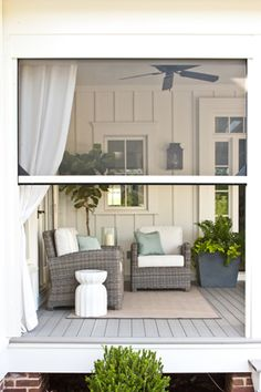 Retractable motorized Executive Screens and Curtains on Front Porch (by Phantom® installed on Southern Living Idea House 2012)