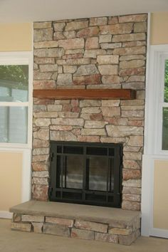 fireplace surround using natural veneer stone with a cut bluestone