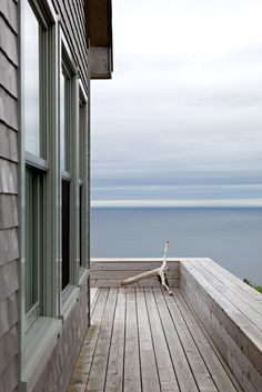 Two interior designers from Los Angeles fell in love with Cape Breton Island in Nova Scotia and built this simple Scandinavian-style cottage on the bluff.