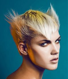A short blonde straight spikey coloured avant garde hairstyle by Sanké...I cannot even imagine what my son would think I sported this new do!
