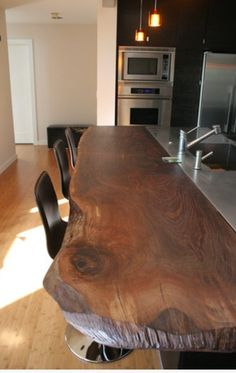 Kitchen island: Raised bar counter in with unfinished corners. Source wood from farm.