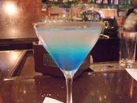 Sharktini (1 1/4 oz Peach Vodka, 1/2 oz Triple Sec, 1/2 oz Peach Schnapps, Splash lime juice, 3 oz, white cranberry, and float of Blue Curacao)