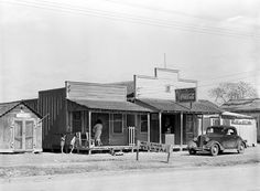 February 1939. Meat market and laundry, Mexican section. Alamo, Texas. Russell Lee for the Farm Security Administration. LC-USF34-032149-D http://www.loc.gov #American #History #Texas