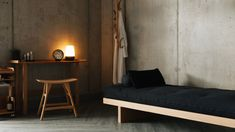 oak-desk-with-osso-stool-and-storage-unit-with-daybed