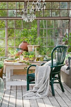 Light, nature, green, white, huge/casual space (table) for productivity. Really like the style combination of rustic elegance.
