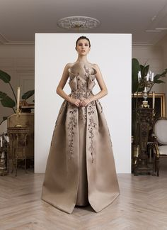 Strapless, double satin, greige gown, with sculptural volume on the bust, and overskirt, embellished with greige floral sequins