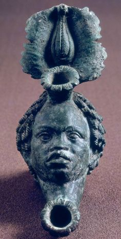 Lamp with Head and Leaves Roman, n. Terracotta, Isolated Ronde-Bosse The Image of the Black in Western Art Research Project and Photo Archive, W. Du Bois Institute for African and African American Research, Harvard University Ancient Rome, Ancient Art, Western Art, Photo Archive, Art History, Renaissance, Roman, Medieval, Harvard University