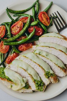 Flavorful pesto chicken and warm, roasted veggies will satisfy your cravings and fill your belly! Healthy Eating Meal Plan, Healthy Dinner Recipes, Healthy Meals, Skinny Chicken Recipes, Green Bean Recipes, Dinner Entrees, Pesto Chicken, Roasted Tomatoes, Green Beans