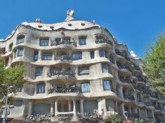 Casa Milà Barcelona, or la Pedrera, by Antoni Gaudí is an apartment building with wavy walls.