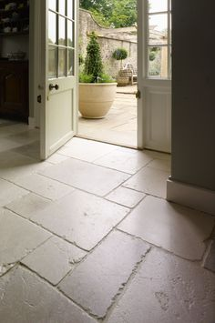 ST ARBOIS TUMBLED LIMESTONE Beautifully aged. A stylish and popular tumbled Limestone with delicate tones of linen, pale greys, creams and the occasional blush of pink. Mandarin Stone