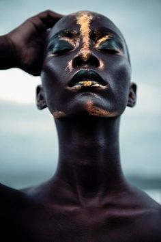 Editorial makeup. Beautiful African skin with gold pigment. Mahany Pery