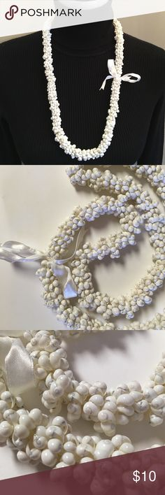 """White Shell Necklace Hawaiian Shell lie Very pretty. Made of tiny white shells. Each tiny shell is strung together to form a circle then threaded on white satin ribbon to form this necklace. Very unique. 32"""" inches long. 3/4"""" inch wide. Tropical Jewelry Jewelry Necklaces"""