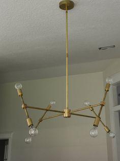 Modern Solid Brass hanging pendant chandelier lighting. The Scarlett model. Sputnik Retro Minimalist style.