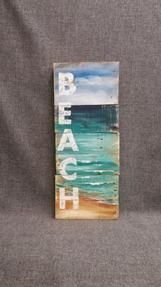 Reclaimed Wood Pallet Art, Hand painted seascape with BEACH wording, Beach, Cottage, upcycled, Wall art, Distressed, Shabby Chic Acrylic painting on reclaimed pallet wood. This unique piece is 9 in wide x 22 in. A nice, summer touch to a front porch, camping trailer, or cottage. **All of my creations are made of reclaimed boards. They are hand painted and are made after they are ordered. Although I try to duplicate original as closely as possible, there may be slight variations because no…