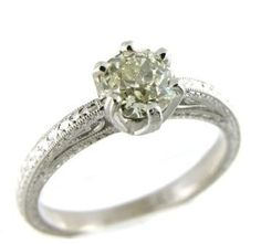 New 18k white gold engagment ring set with an old mine cut diamond weighing 0.75ct of SI2 clarity and O-P color.