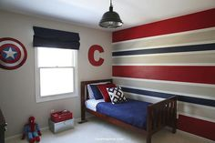 I like the stripe wall and then we can put super hero pics above bed
