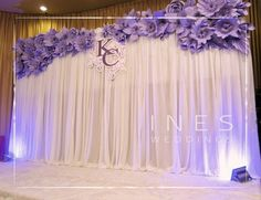 May do something like this in our colors to cover up the uglier wall color of the reception hall.: