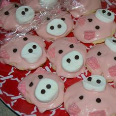 1/4 Marshmellow (snout)  Mini Chocolate Chips (eyes/nostrils)  Pink Wafer Cookies cut into triangles (ears)