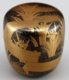 Japanese lacquered tea box or caddy (Usucha-ki or natsume) for holding the powdered tea used in tea ceremony, gold iris flower and leaves design on black, lacquered wood, 20th century, Japan