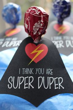 It's a bird....it's a plane....no, it's a flying Tootsie pop. Print, cut and punch a hole into these super hero inspired valentine's day cards for a cheeky favor this year.