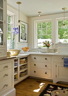 Some of the upper cabinet doors were removed in favor of glass-front doors, which also helps to create a feeling of openness in the tiny kitchen space.