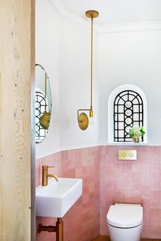architect Penny Kinsella and interior designer Susie Cohen (Made by Cohen) both credit their united front when it came to the successful transformation of this large, disjointed Melbourne residence into a bright, elegant and refined family home. Pink Bathroom Tiles, Pink Tiles, Modern Bathroom, White Bathroom, Pink Bathroom Vintage, Kmart Bathroom, Pink Bathrooms, 1950s Bathroom, Mirror Bathroom