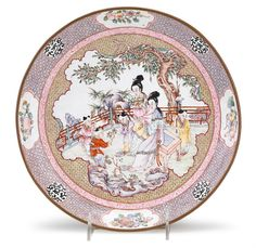 ASIAN ARTS - SALE 1485 - LOT 187 - FREEMAN'S AUCTIONEERS. Chinese canton enamel dish  qianlong period  Decorated to interior with boys and maidens in a garden setting, surrounded by bands of daiper ground, stylized scrolls and fruiting sprays; the back enameled with a central dragon roundel encircled by flowering and fruiting sprays against a lemon yellow ground.  D: 10 3/4 inches   Estimate $3,000-5,000