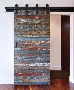 Barn door- totally doing this for the doorway from kitchen to bedroom hallway and widening the front hallway door and leave that an open doorway looking straight through to the family room.