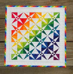 Rainbow quilt; fun use of brights and white. This is for beach picnics and boating!***