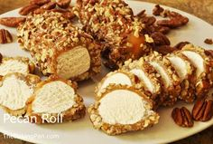 Pecan Rolls Candy Recipe - TheBakingPan.com - How to Make Pecan Rolls  Pecan rolls, also known as Pecan Logs, are an old-fashioned Southern confection. Pecan rolls traditionally have a light and fluffy nougat or divinity-type center that is formed into rolls, dipped into a rich, hot caramel, and then rolled in crunchy toasted chopped pecans.