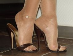 "Pretty ""Heels"", arches and toes in sheer shiny nylon in sexy mules. #stilettoheelsnylons"