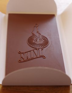 """The """"Chocolate Naive"""" milk chocolate: Pretty bar and pretty to eat. Very intense, slightly smoky flavors...one of my favorite milk chocolates!"""
