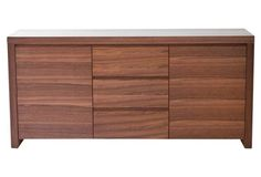 Bowen Buffet, Walnut. With two doors and three drawers, this sideboard can be used as a buffet in a dining room, a credenza in an entry, or a dresser in the bedroom.