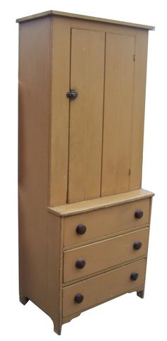 Early 19th century Stepback Cupboard over three drawers, in old mustard paint, the drawers are dovetailed, circa 1840 all original  www.mycountrytreasures.com