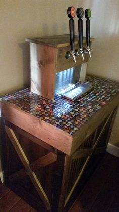 Keezer with beer bottle cap counter top.